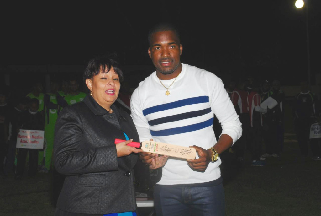 FLASHBACK: Photos shows T&T and West Indies star batsman Darren Bravo presenting MP of Cumuto/Manzanilla Mrs. Christine Newallo-Hosein with a TML Cricket memorabilia bat at the 2015 Opening Ceremony.